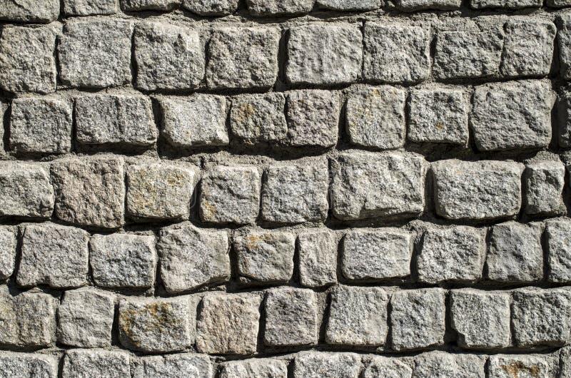 La pared gris del granito pavimenta imagenes de archivo