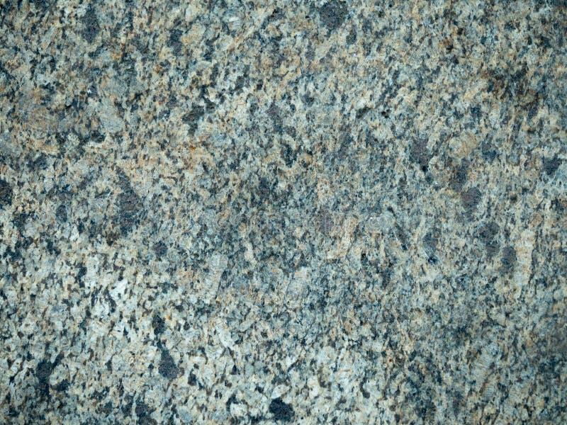 La pared gris hecha del agregado de mármol, se cierra encima de la visión abstraiga el fondo Cierre global de mármol de la textur fotos de archivo
