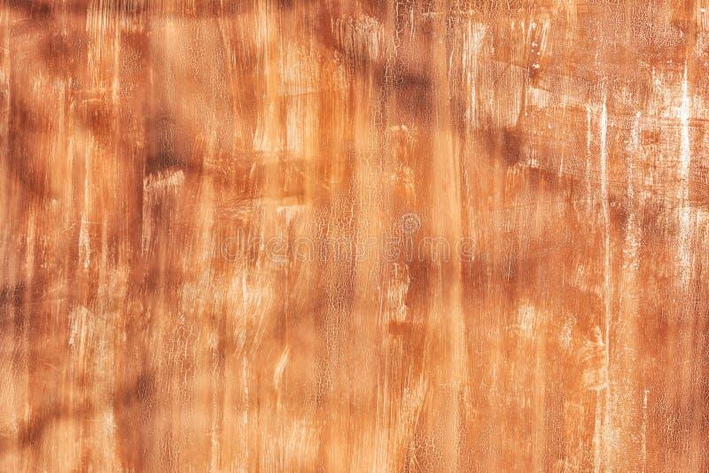 La pared vieja se pinta irregularmente con la pintura anaranjada E foto con textura blank fotografía de archivo libre de regalías