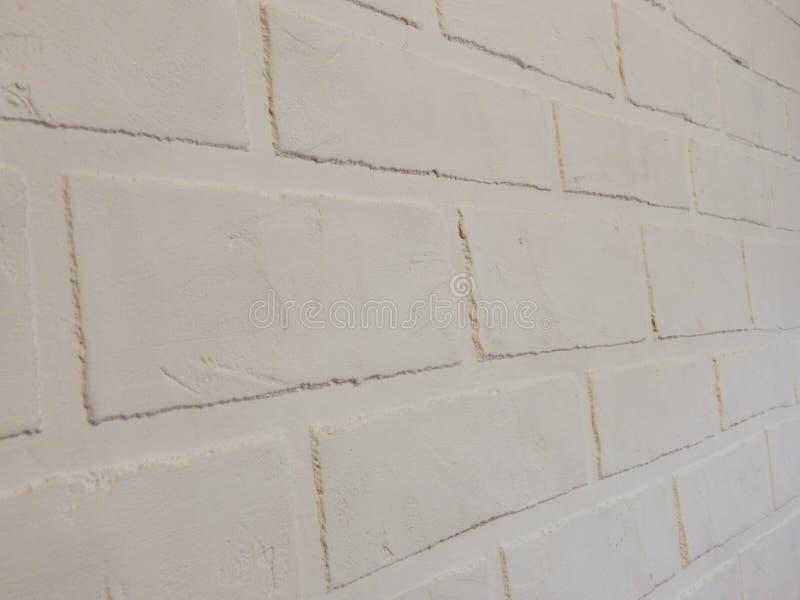 La parete del fondo di questo gesso bianco del mattone immagini stock