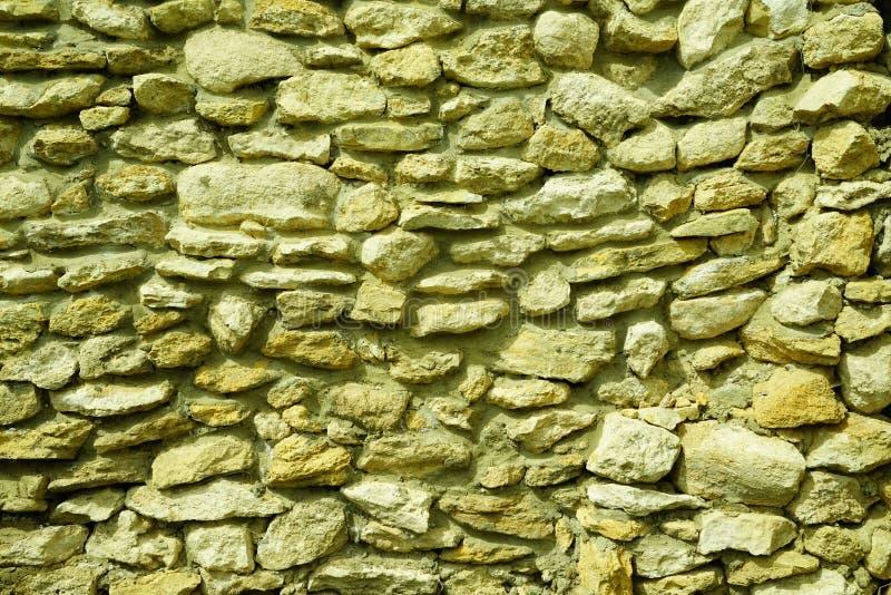 La parete di macerie, le coperture della muratura immagine stock