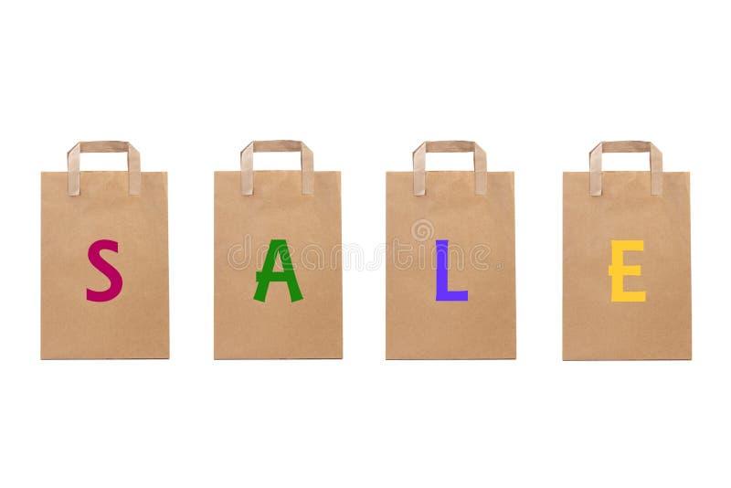 La parola di vendita scrive in sacchi di carta differenti fotografia stock