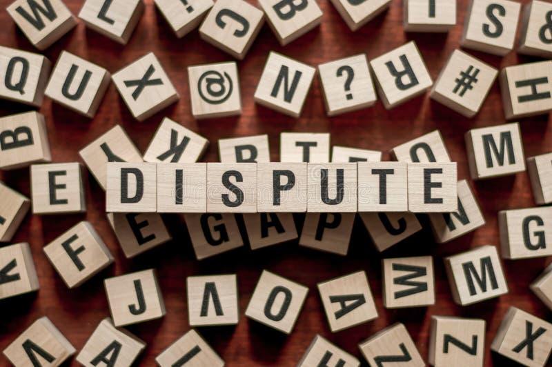 La parola 'disputa' sul concetto dei mattoni immagini stock