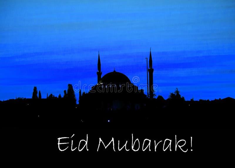 la parola EID MUBARAK scritto accanto ad una moschea fotografie stock