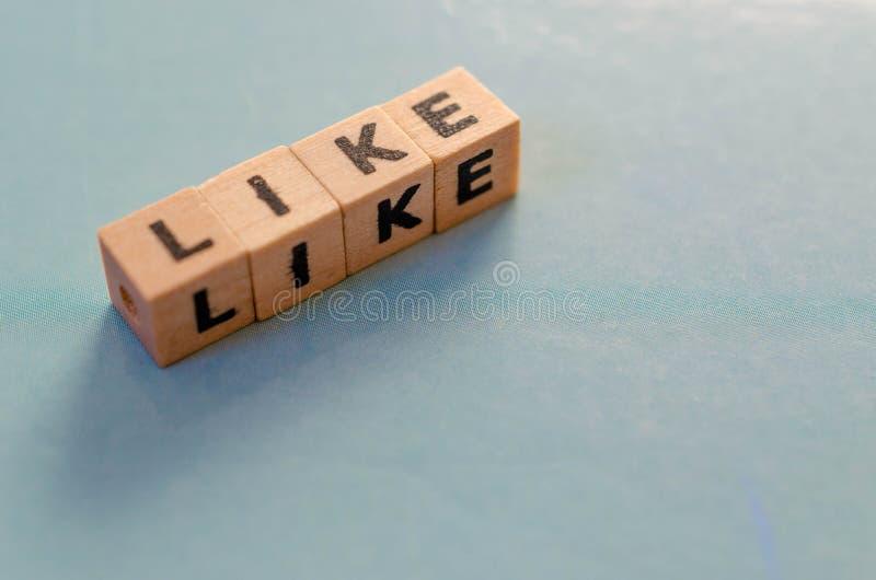 La parola gradisce scritto in cubi fotografia stock