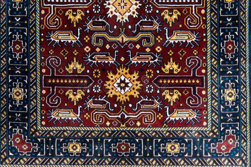 La parte del tappeto fatto a mano dell'turco-Azerbaigian fotografia stock