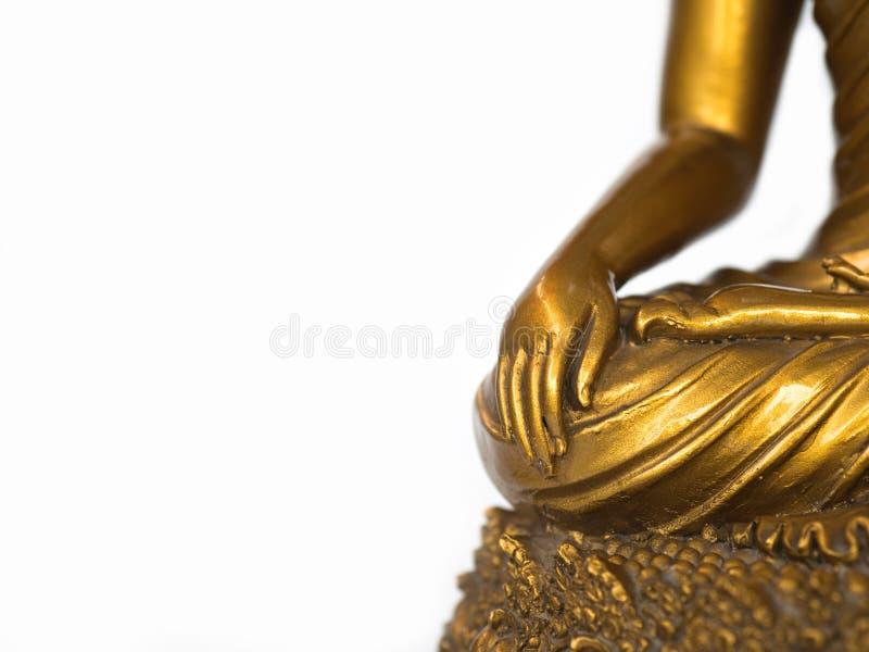 La parte della statua antica dorata di Buddha sui precedenti bianchi ha isolato il fondo copyspace per testo ed il contenuto fotografia stock