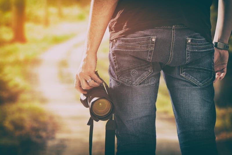 La passion de personne de photo de dslr d'appareil-photo photographique de photographe se surpassent photographie stock libre de droits