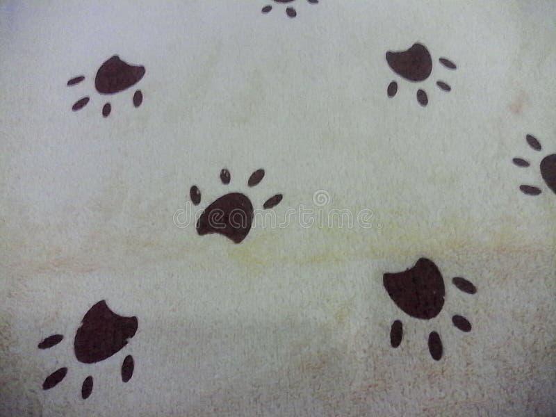 la pata del perro del pie de los gogs de la tela imprimió la cama del animal doméstico foto de archivo libre de regalías