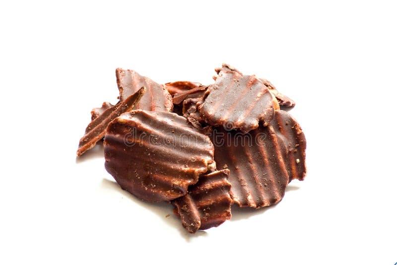 La patate douce ébrèche avec du chocolat sur la terre blanche image stock