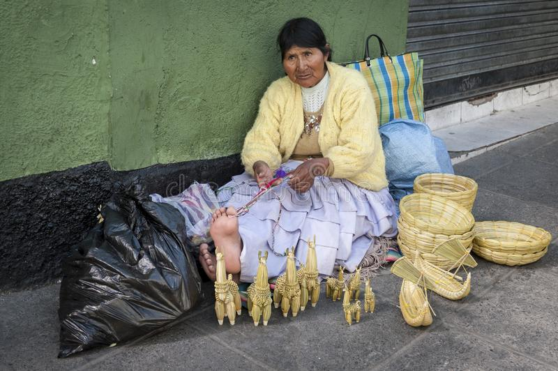 LA PAZ, BOLIVIA - AUGUST 19, 2017 : Unidentified street woman vendor wearing traditional clothing in the local Rodriguez market, s stock photos
