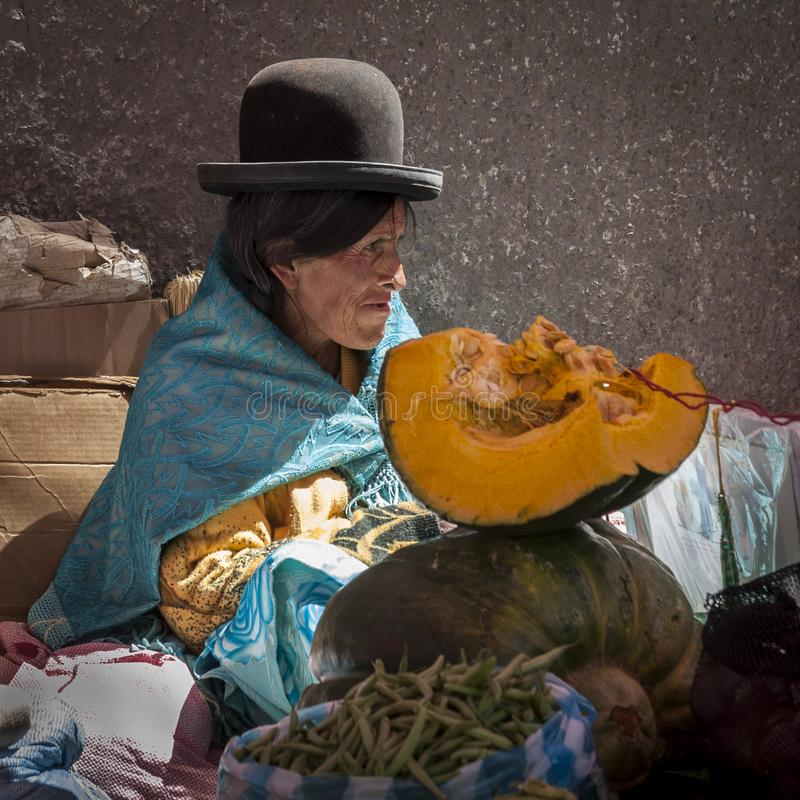 Unidentified street woman vendor wearing traditional clothing in the local Rodriguez market, selling vegetables, La Paz - Bolivia royalty free stock photo