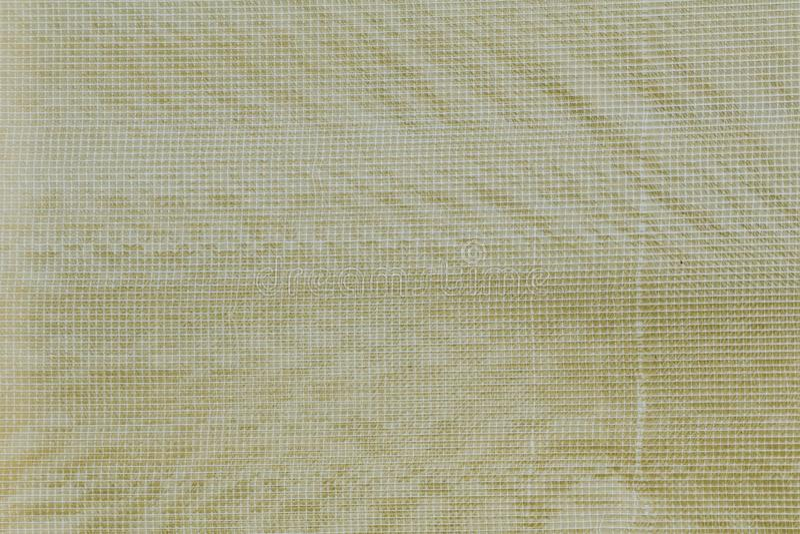 La pellicule de polyéthylène jaune a renforcé le fond photo stock