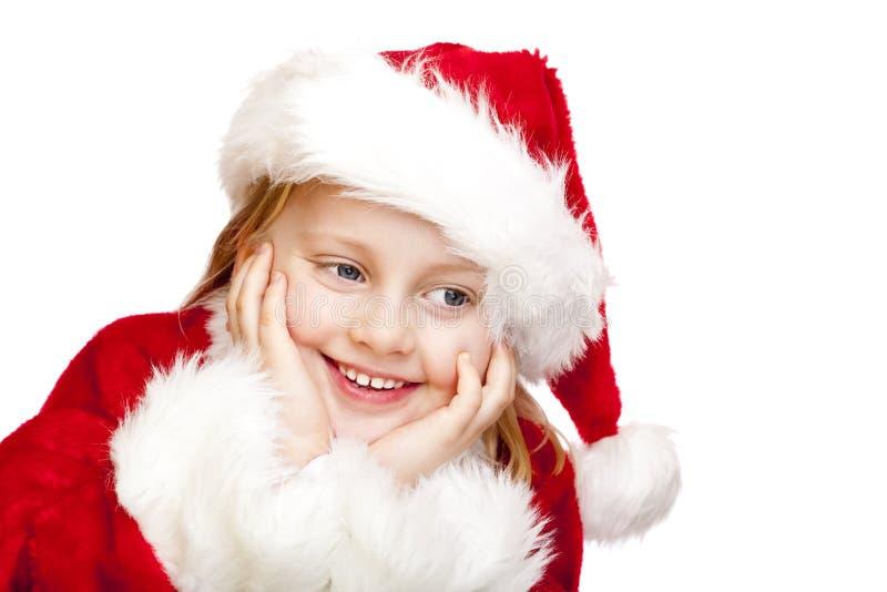 La pequeña muchacha vestida como Papá Noel sonríe feliz imagen de archivo libre de regalías