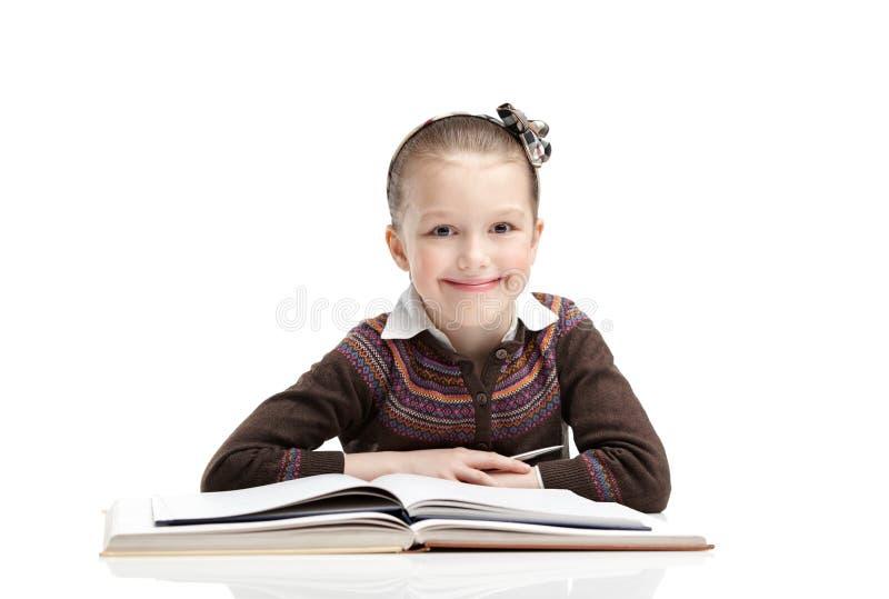 La pequeña pupila tiene gusto de estudiar fotografía de archivo libre de regalías