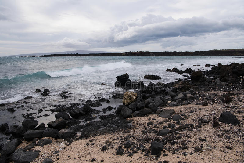 La Perouse Bay. Black lava stones from the latest eruption of the Haleakala volcano at La Perouse Bay. The bay was named for the French explorer Captain Jean royalty free stock photos