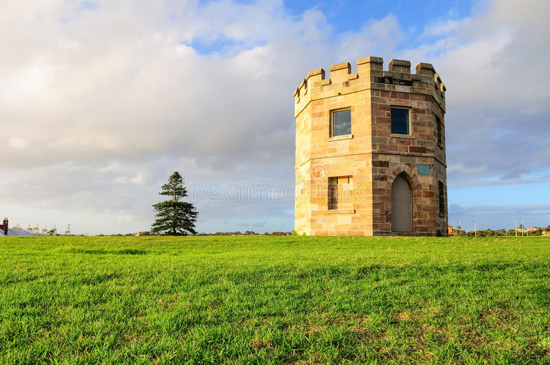La Perouse's 19th century Customs tower on sunset royalty free stock photo