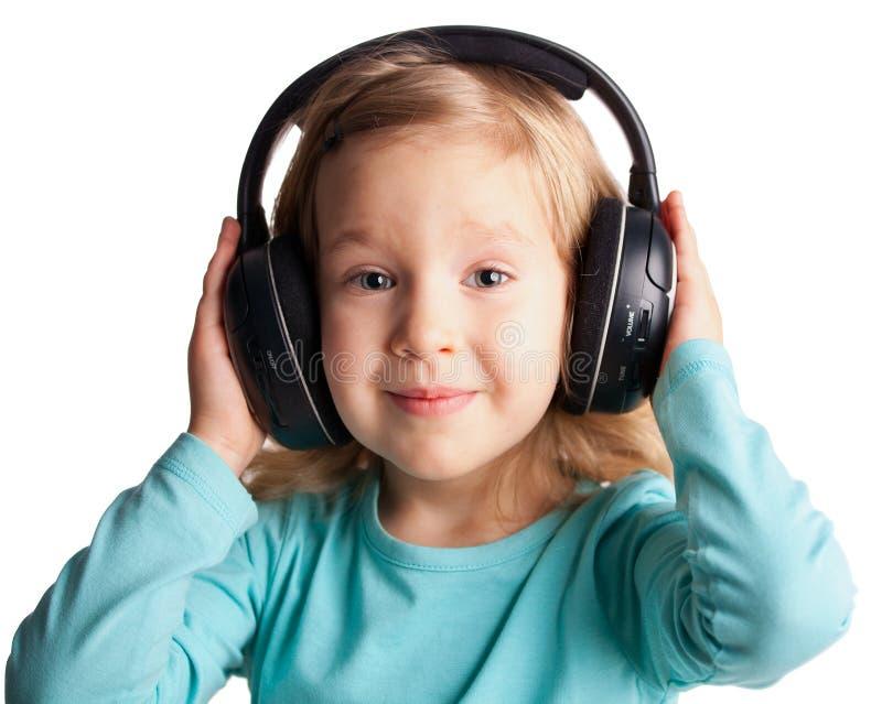 La petite fille écoutent musique photo stock