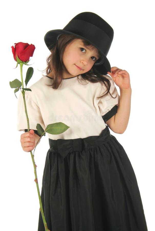 La petite fille avec s'est levée photographie stock libre de droits