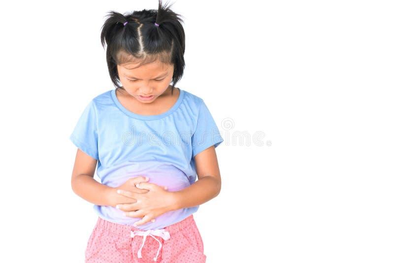 La petite fille a le mal d'estomac sur le blanc photos libres de droits