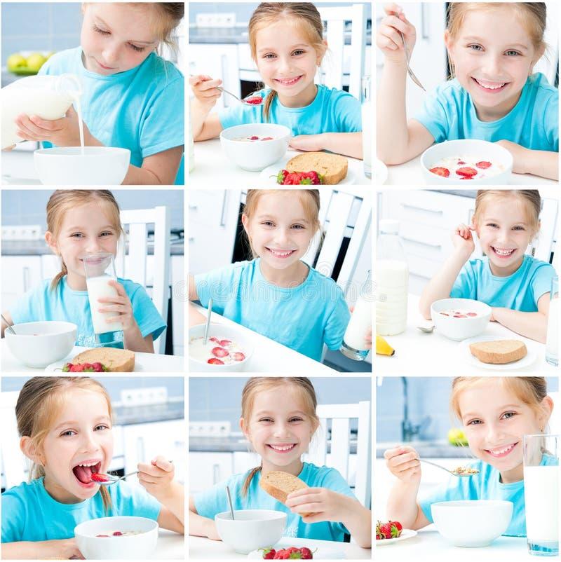 La petite fille prennent un petit déjeuner image stock
