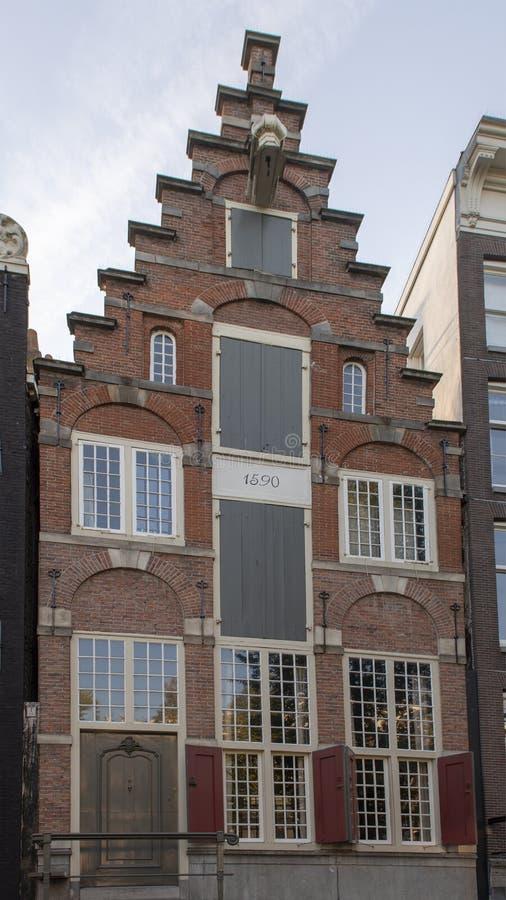La più vecchia casa residenziale a Amsterdam, parte di sinistra del canale di Herengracht, Paesi Bassi fotografie stock libere da diritti