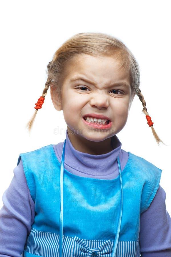 La piccola ragazza impertinente propone i fronti immagine stock libera da diritti