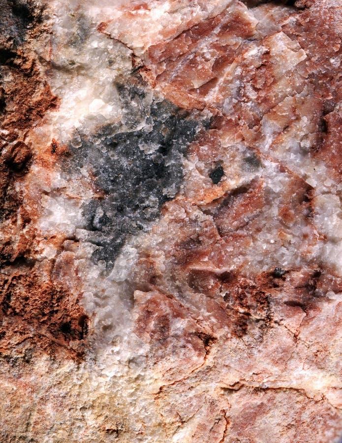 La piedra roja con blanco y negro asperja imágenes de archivo libres de regalías