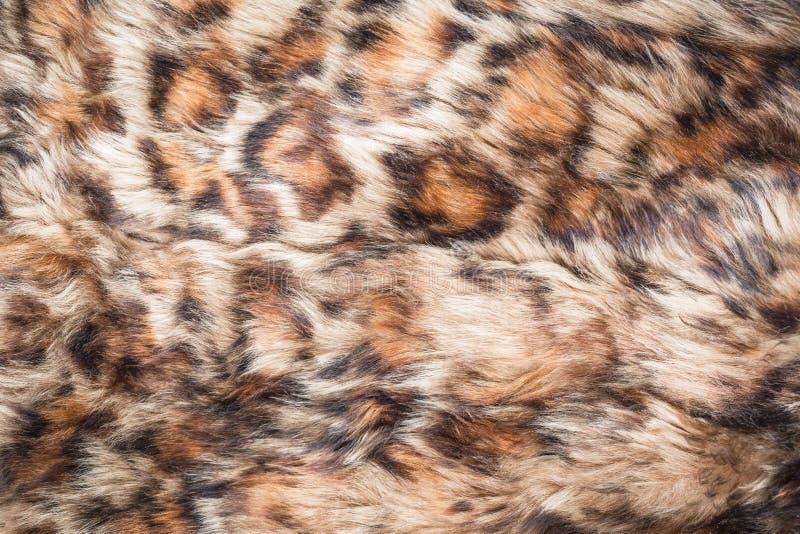 La piel larga del estampado de animales texturizó el fondo de la pantera imagen de archivo libre de regalías