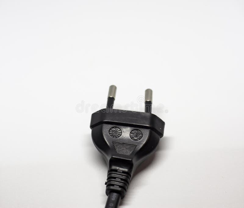 La pierna negra del enchufe dos de la electricidad fotografía de archivo libre de regalías