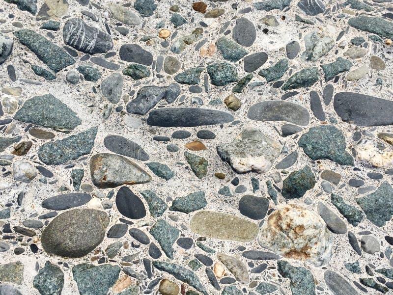 La pierre concrète superficielle par les agents lapide le fond photo stock