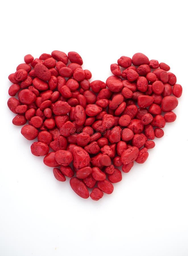 la pierre rouge est forme de coeur photos stock