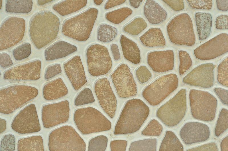 La pietra è una piastrella di ceramica con un modello di pietra rotondo fotografia stock libera da diritti