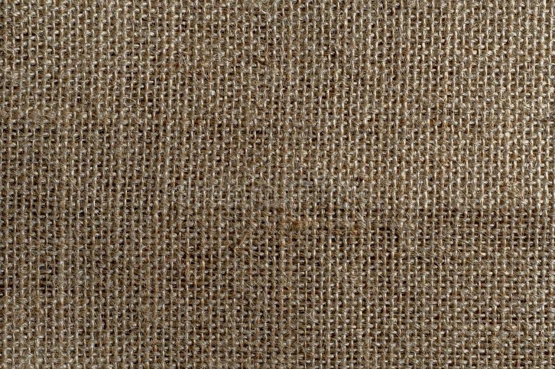 La pietra ha lavato la struttura di tela pura Fondo di tela corrugato del tessuto Struttura di tela naturale fotografia stock libera da diritti