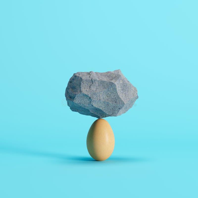 La pietra ha messo sopra l'uovo su fondo blu illustrazione di stock