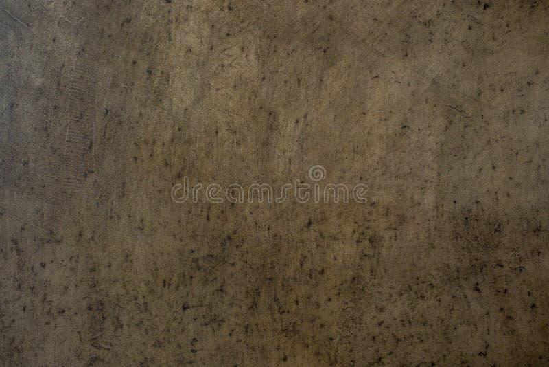 La pietra ruvida concreta, di struttura del cemento della crepa parete dello stucco intonacata roccia ha dipinto il grano grigio  fotografia stock