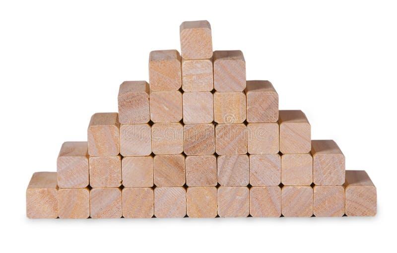 La pila della piramide dai blocchi di legno gioca immagini stock libere da diritti
