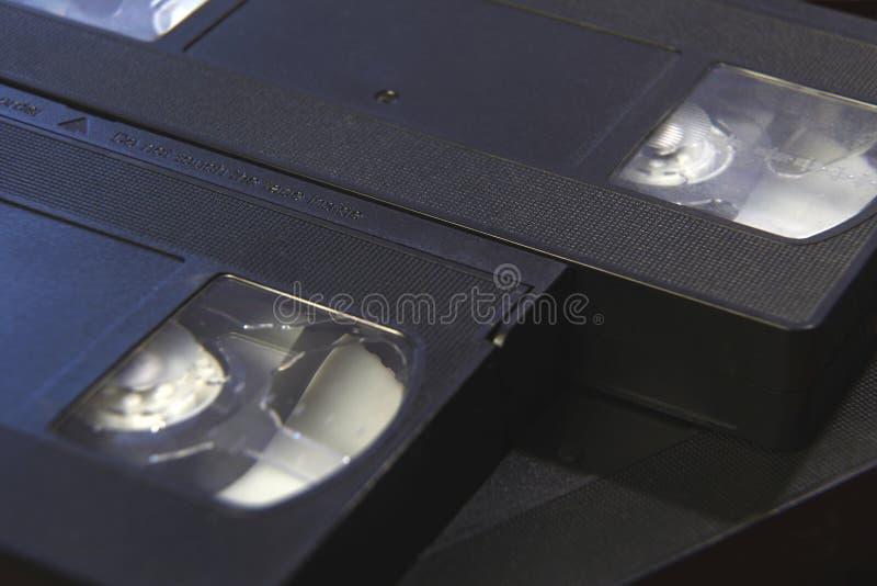 La pile de cassettes vidéo de bande noire de VHS se ferment  photo stock