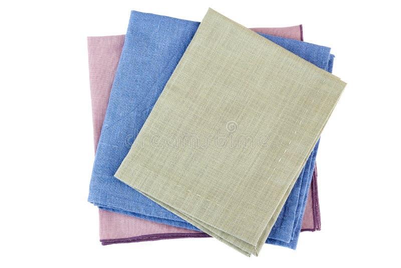 La pile de trois fois des serviettes de textile sur le blanc photographie stock