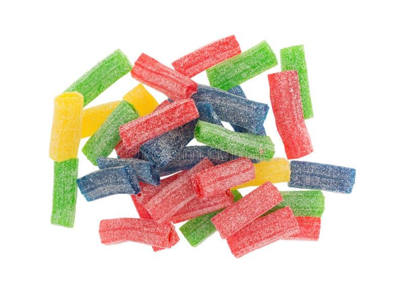 La pile du sucre a enduit la sucrerie douce et aigre gommeuse photographie stock libre de droits