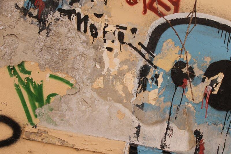 La pintada cubrió la pared foto de archivo