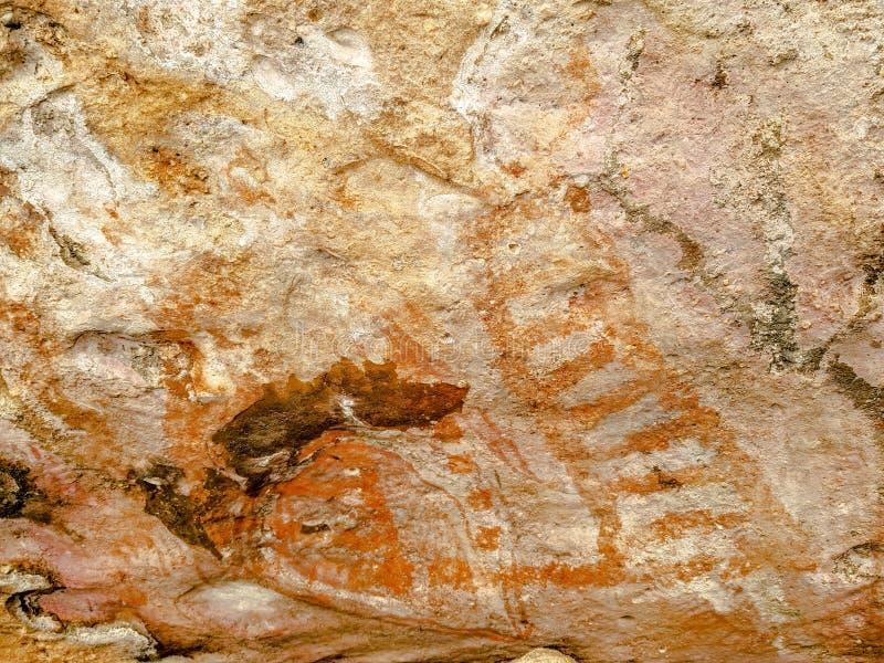 La pittura preistorica della scala o dello speciale firma sullo scaffale della roccia nel parco storico del pipistrello di Phu Ph fotografia stock