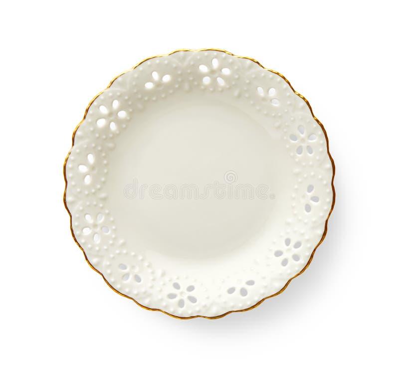 La placa vacía con el borde de oro del modelo, la placa redonda blanca ofrece un borde hermoso del oro con el estampado de flores foto de archivo