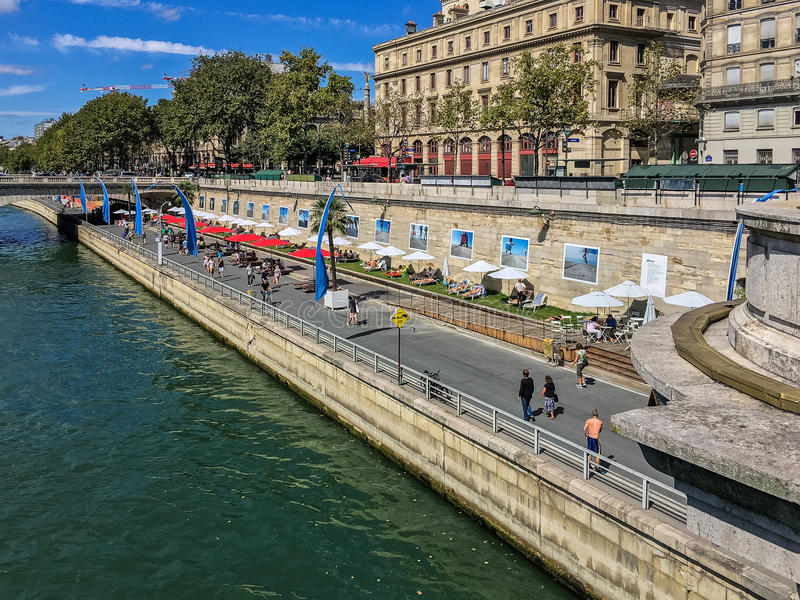 La Plage on the banks of the Seine in Paris, France,. La Plage, the summer beach, on the banks of the Seine River in Paris, France, late summer, with beach stock images