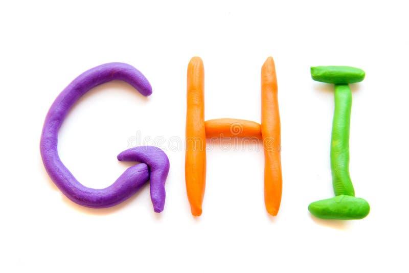 La plastilina segna GHI con lettere fotografia stock