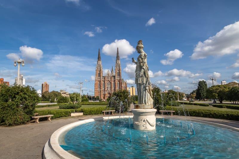 La Plata Cathedral and Plaza Moreno Fountain - La Plata, Buenos Aires Province, Argentina. La Plata Cathedral and Plaza Moreno Fountain in La Plata, Buenos Aires stock photo