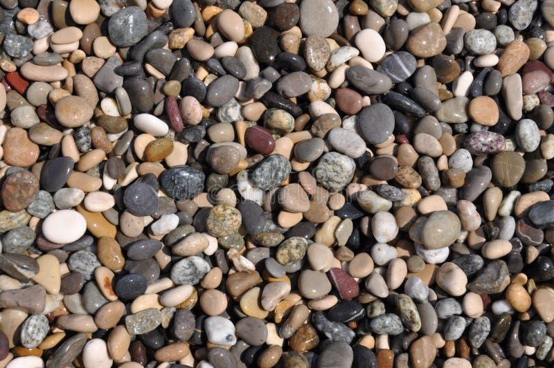 La playa empiedra el primer como fondo foto de archivo libre de regalías