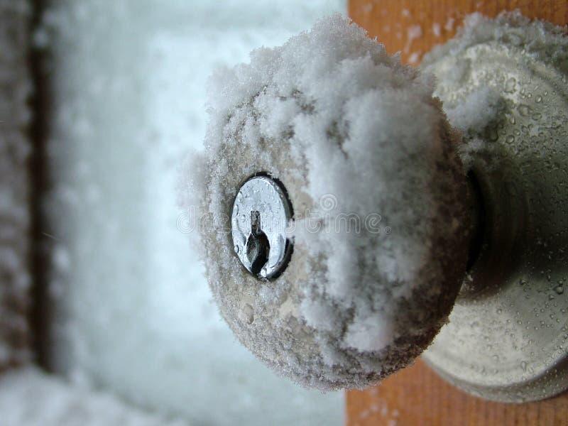 La poignée de porte de l'hiver photographie stock libre de droits