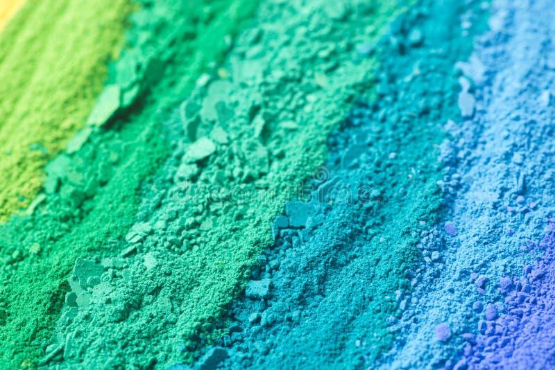La poudre multicolore pigmente le fond image libre de droits