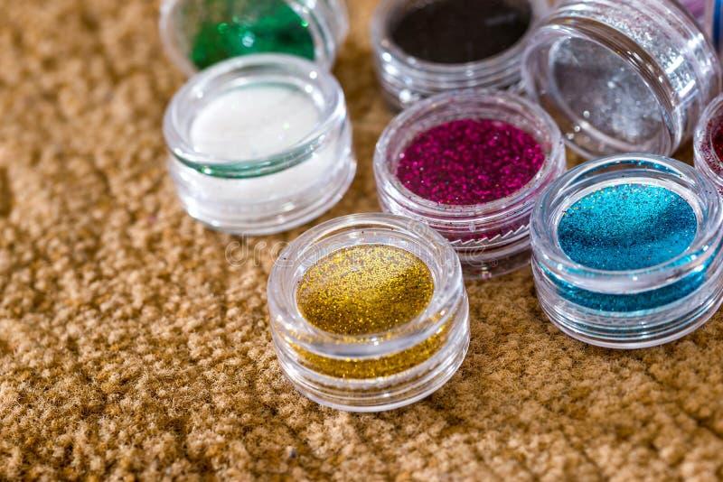 La poussière UV de poudre pour l'ongle polonais photo libre de droits